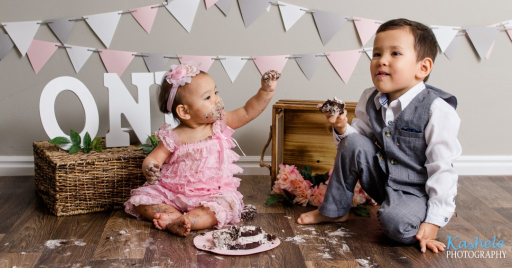 Sister sharing her cake with brother for Utah County Cake Smash
