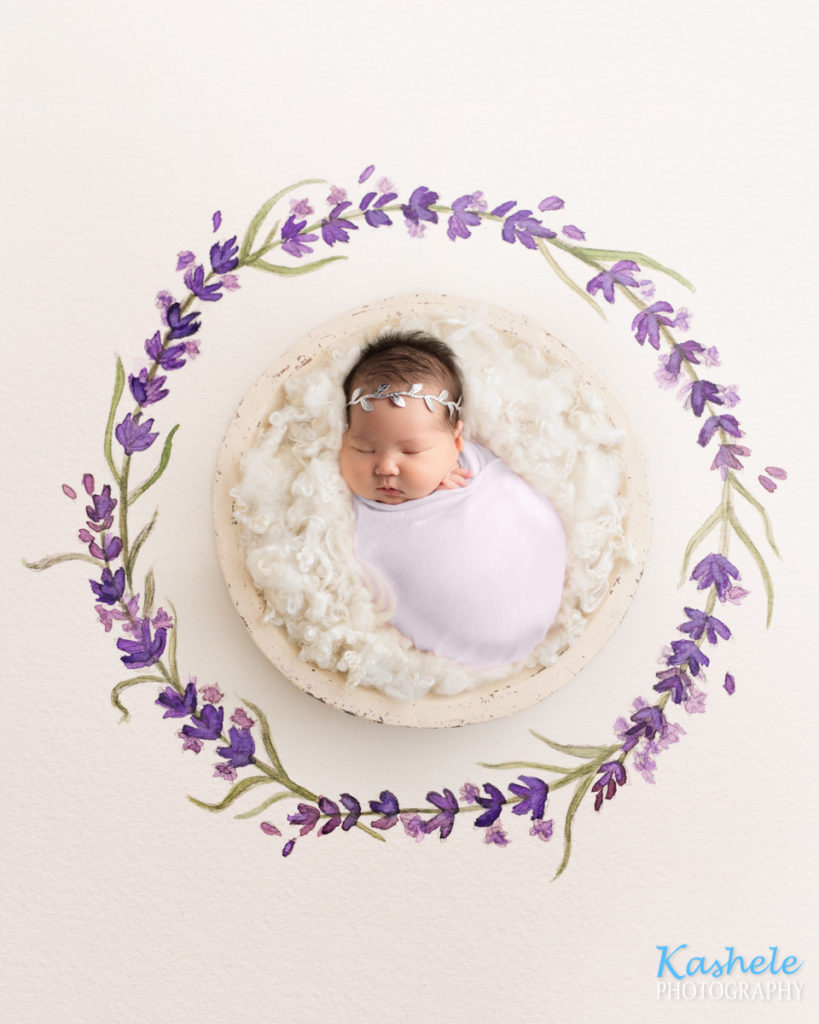 Image of baby girl on a watercolor flower drop for Eagle Mountain Newborn Photography post