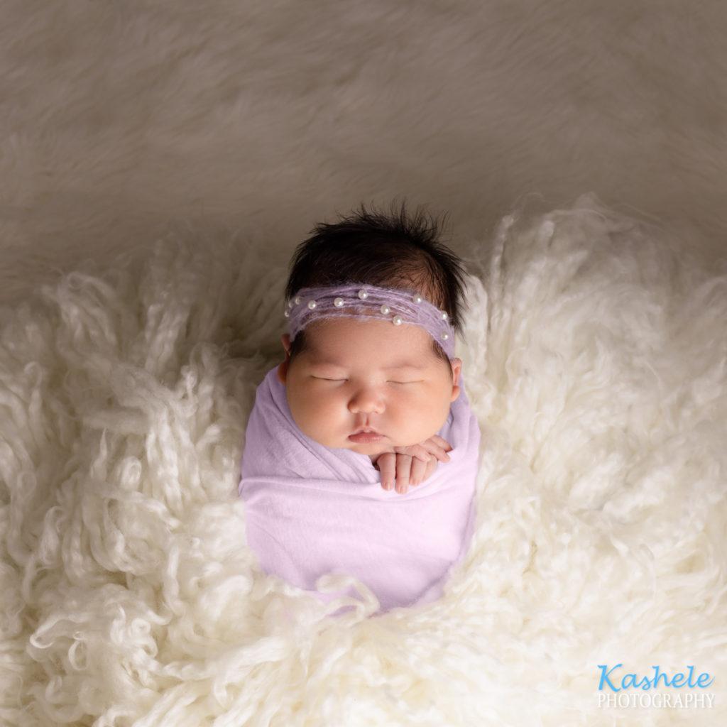 Image of baby girl in potato sack pose