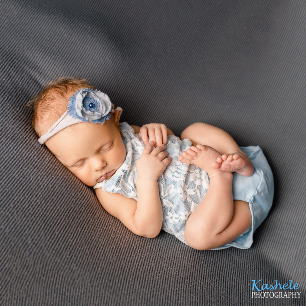 Image of baby girl in blue for Logan Newborn Photography post