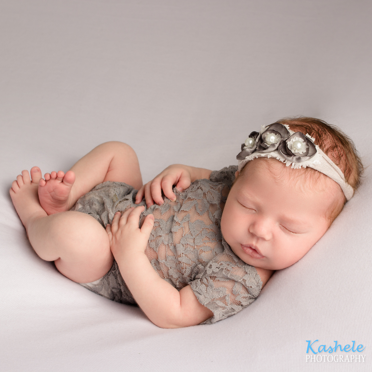 Huck Fin pose for Utah County Newborn Photography Post