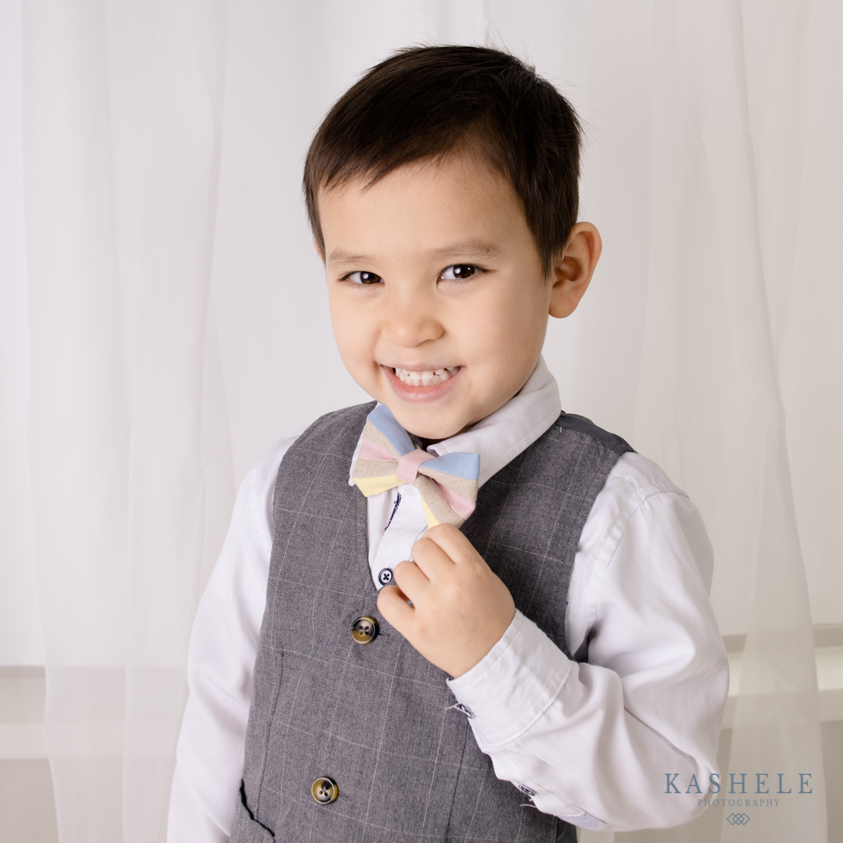 Image of little boy holding his Easter My Little Itch bowtie