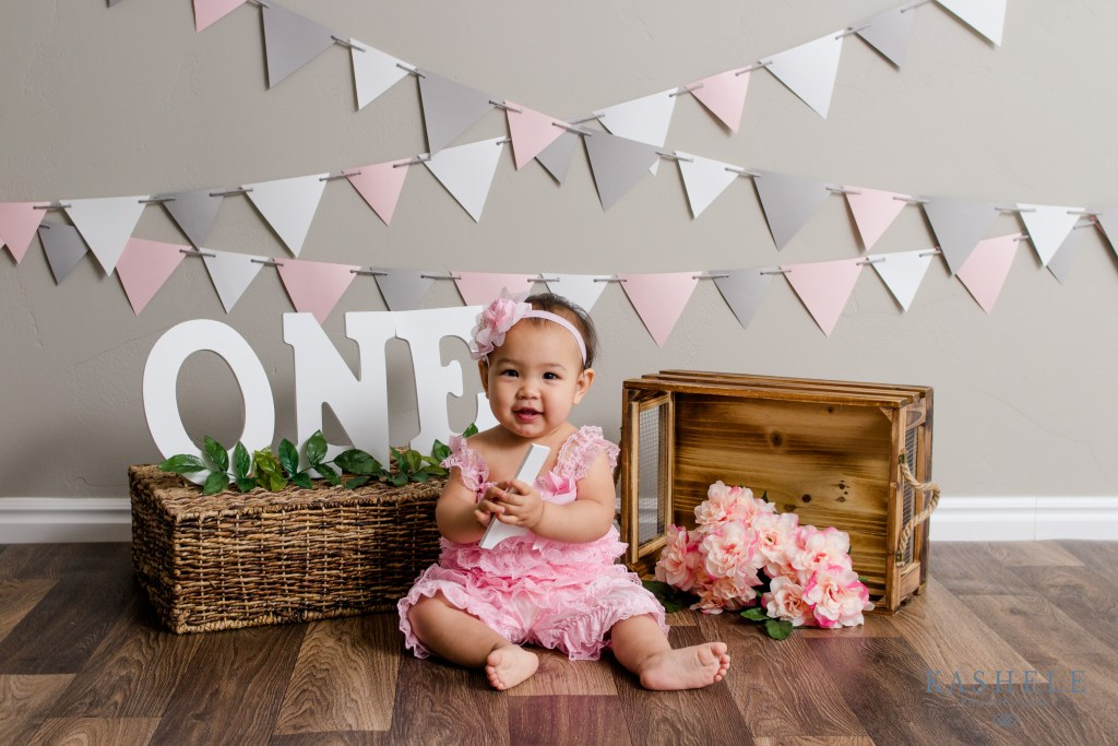 One year birthday session for little girl in pink