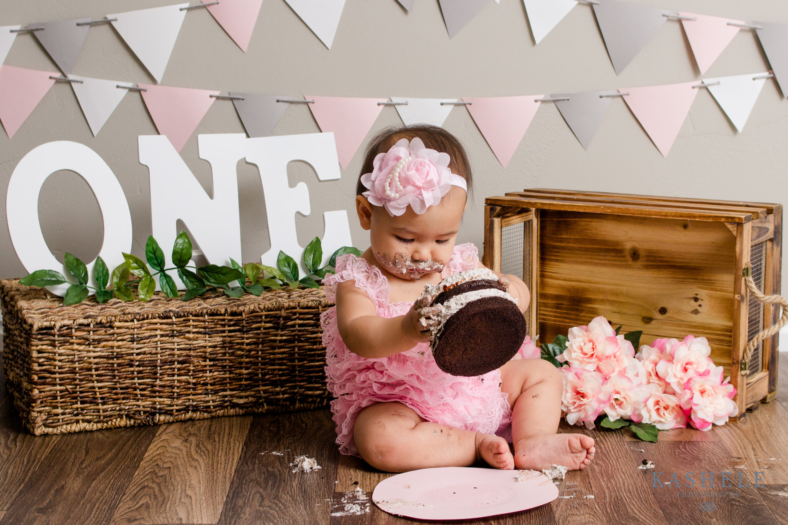One year cake smash for little girl in pink