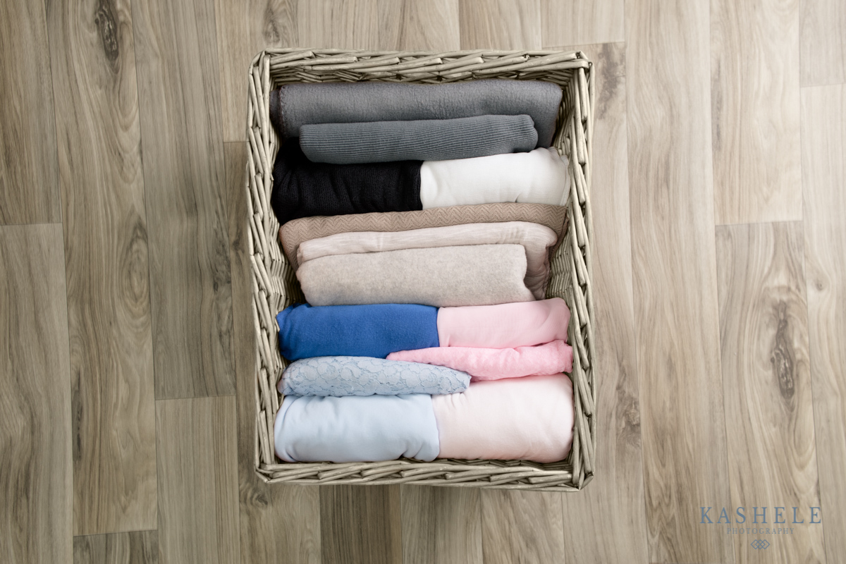 image of my collection of beanbag backdrops to use for a newborn session