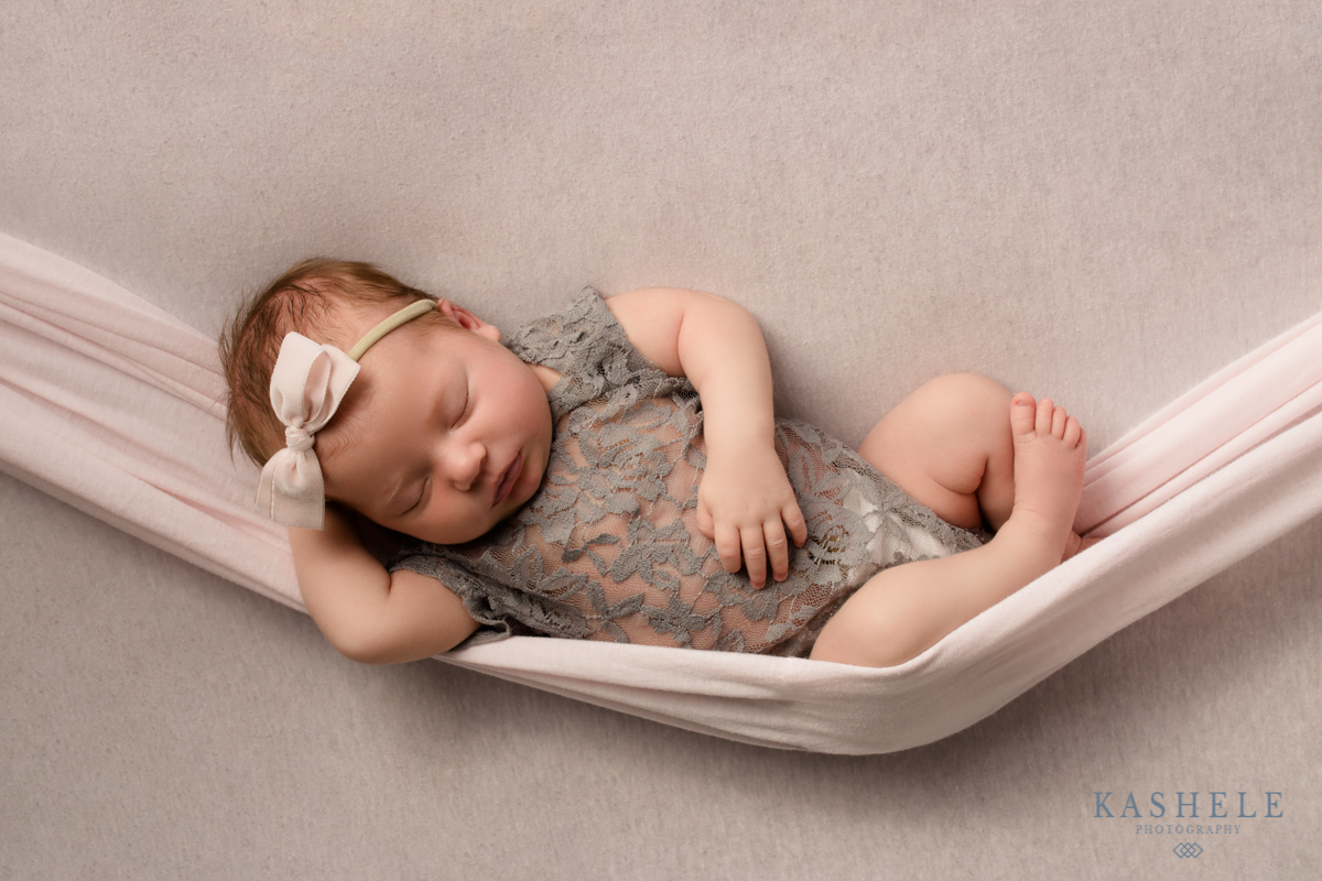 Hammock pose for Guide to Newborn Poses post