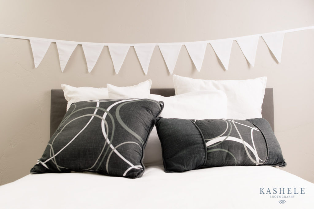 Image of white bunting banner hanging over a bed