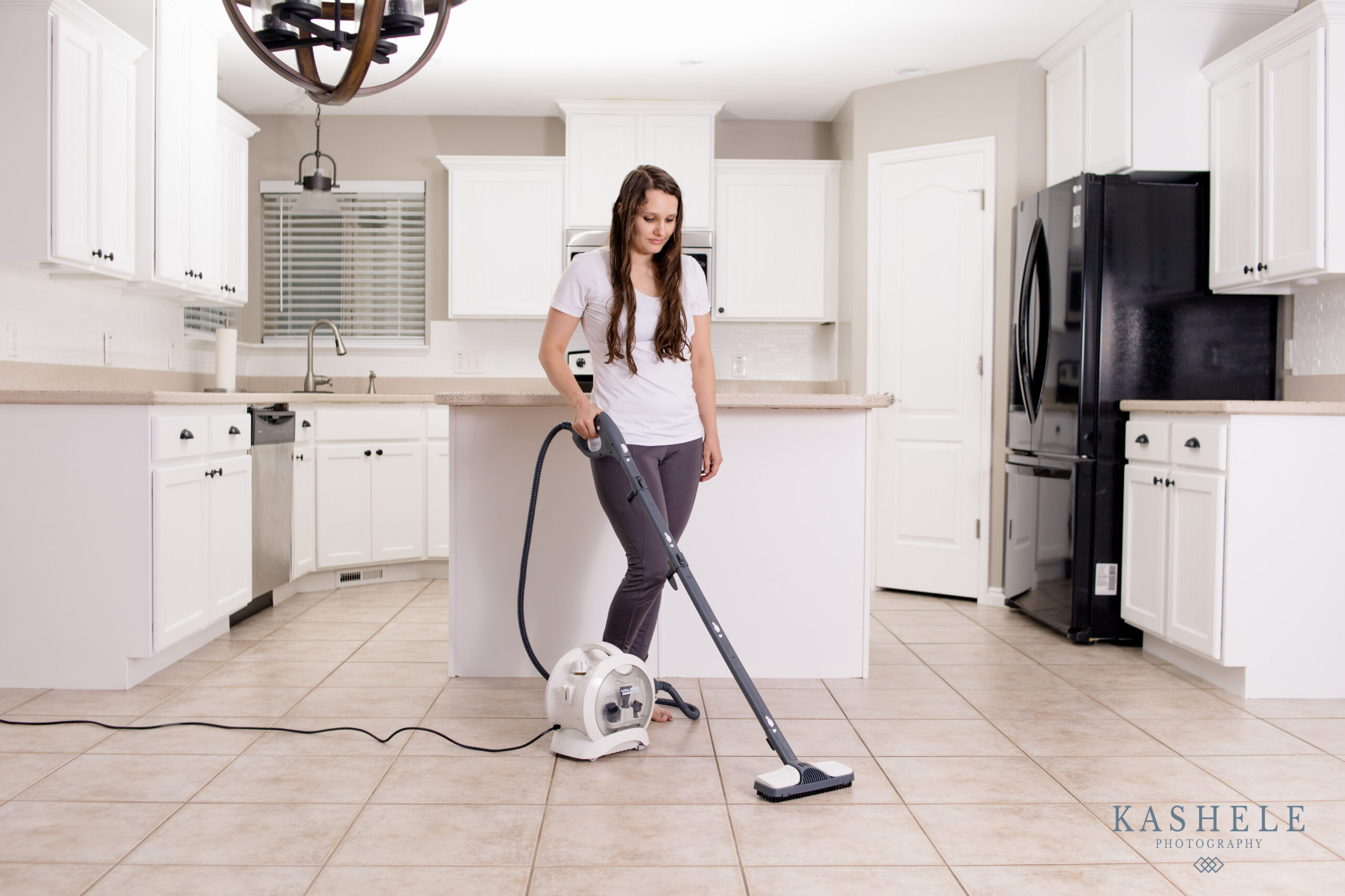 Lifestyle product photography image of floor steam cleaner