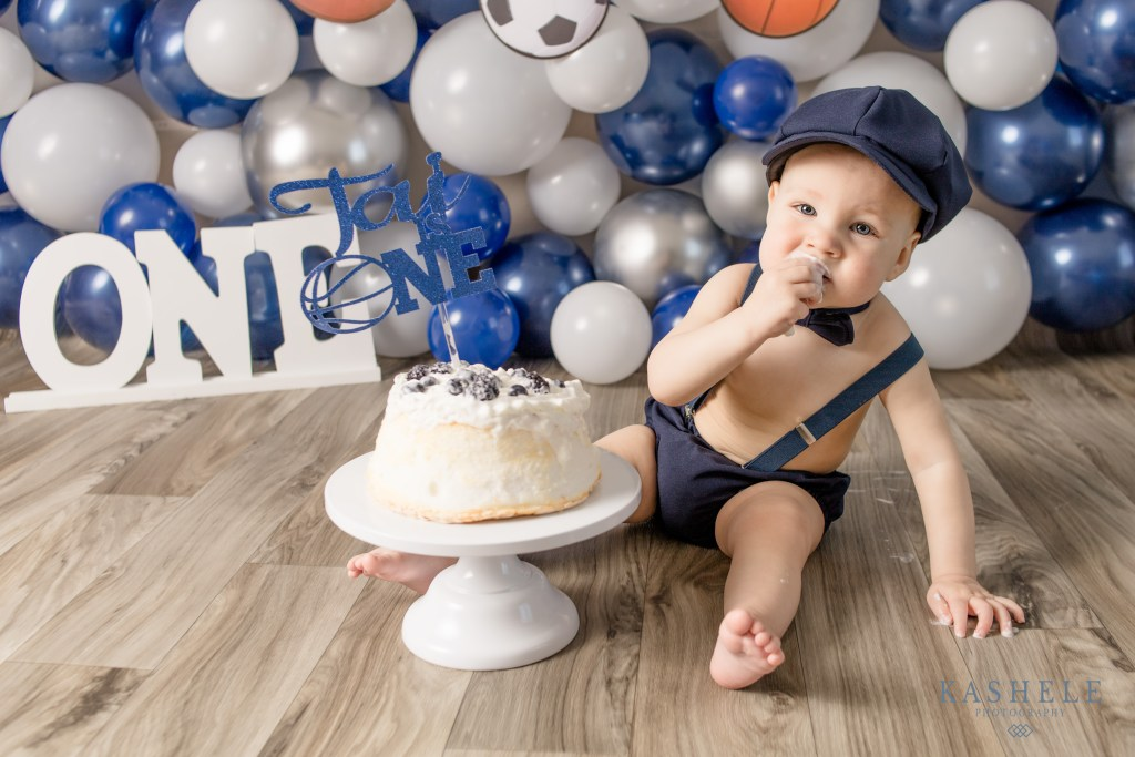 Image of Baby boy with a Sports themed Navy Blue Cake smash