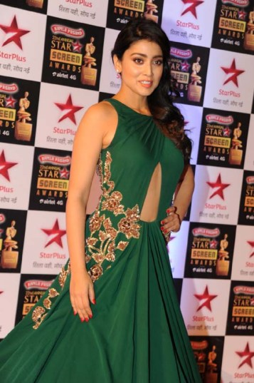 One of my favourite - Shriya Saran in a deep green gown that adds to her beauty