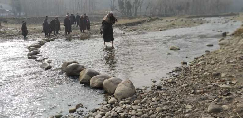 People of this Pattan village cross river to reach the road