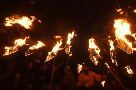 Activists and supporters of Jammu Kashmir Liberation Front (JKLF) hold torches during a protest march to mark International Human Rights Day in Srinagar -- Photo: Bilal Bahadur.