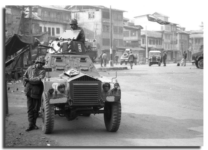 A soldier stands gaurd in Bohri Kadal on January 22, 1990 a day afetr the massacre -- Photo: Mehraj Din