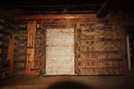 The original lattice window filled with bricks on the first floor of the Khanqah --Photo: Bilal Bahadur