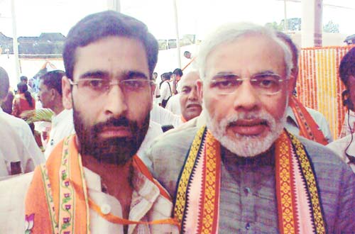 Aashiq Hussain Dar , State Vice-President, BJP's Youth Wing Kashmir, with Gujarat chief minister Narendra Modi at a function in Mumbai.