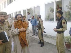 Gulzar Ahmad Bhat in police custody in Budgam