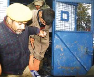 A stone pelter being taken for court hearing. Pic: Bilal Bahadur