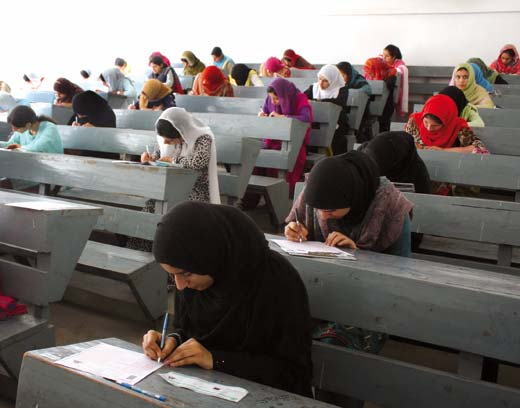 Students writing BOPEE held CET in a Srinagar college in this KL file Image.