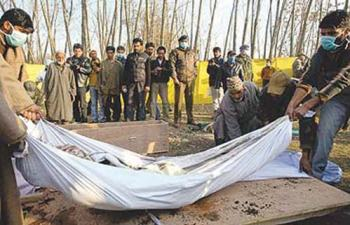 Exhumation of bodies of Pathribal fake encounter victims in this March 2000 file pic.