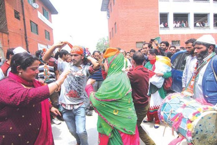 Kashmiri BJP supporters celebrating their party's landslide victory in the last Lok Sabha election in Srinagar. Pic: Bilal Bahadur