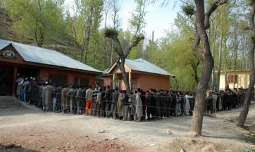 People in a queue waiting for their turn to cast their vote.  Pic: Bilal Bahadur