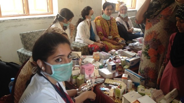 Kashmiri students from Al-Ameen Medical College  Bijapur attending patients at a camp in Pampore