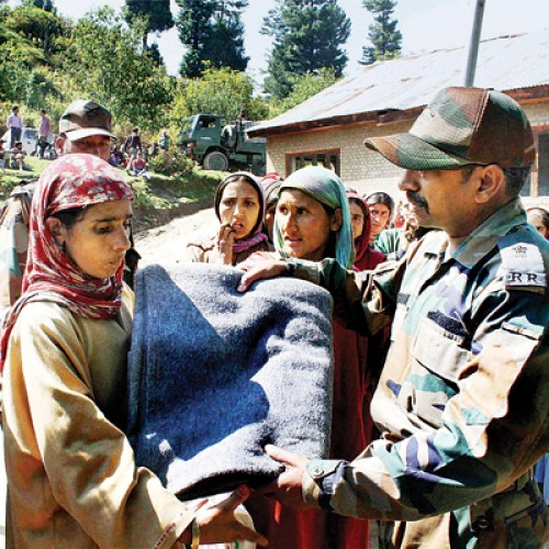 Army official distributing relief in Darwan Budgam.