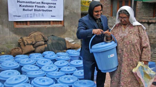 Head of Faizal & Shabana Foundation Dr. Joseph Sebastian giving away Hygiene Kits in Srinagar. (Photo By: Bilal Bahadur)