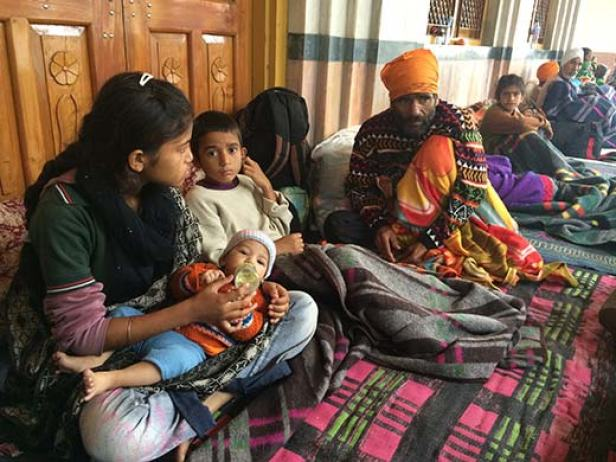 Flood-displaced families inside the hall of Gurduwara