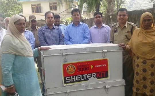 Police officials busy distributing relief somewhere in Poonch.