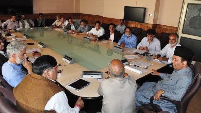 State Finance Minister Rahim Rather during a meeting with traders.