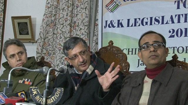 Flanked by Kashmir Police Chief A G MIr, CEO J&K Umang Narula addressing press conference in Srinagar.