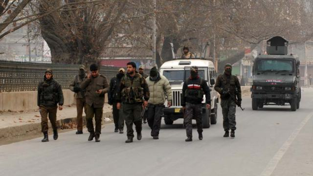 Security personnel are marching on Srinagar roads