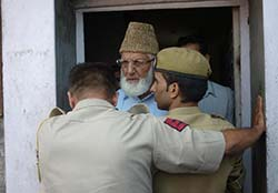 A file photo of Syed Ali Geelani when he tried to break his house detention.