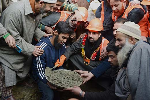 Mirwaiz stepping into the shoes of construction worker.