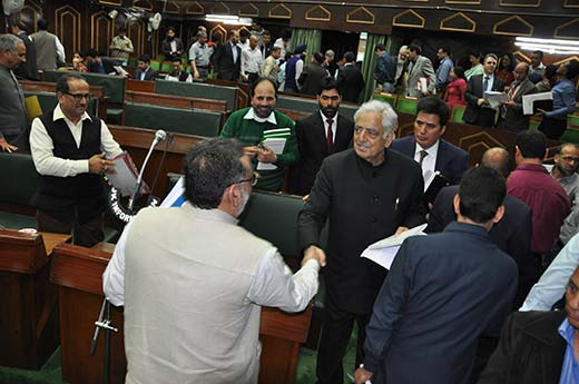 Dr Haseeb Drabu being congratultaed by former CM Mufti after presenting budget in JK assembly in 2015.