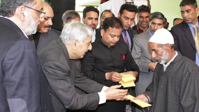 CM Mufti Sayeed in South Kashmir distributing post flood Relief Cheques with Fin Min Dr Haseeb Drabu on Thursday.