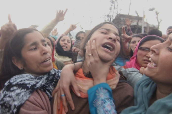 Kashmiri Muslim women mourn during the funeral procession of Altaf Hussain Wani in srinagar, the summer capiatl of indian kashmir on 13/3/2013 ,35 year-old youth was killed today when CRPF personnel allegedly opened fire after coming under attack by a group, The vehicle of CRPF personnel was on its way to SKIMS hospital, where the victims of this morning's Bemina terror attack are admitted, when it came under attack in Zoonimar area, sources said. Photo/Altaf Zargar/Zuma Press