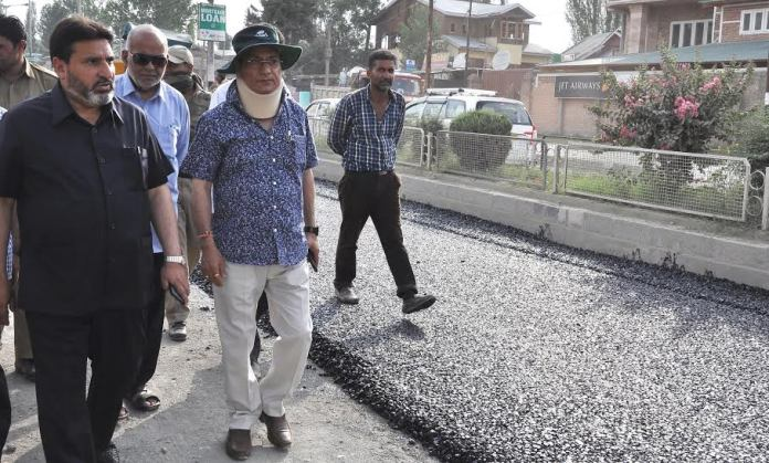 In this KL file Image, then R&B Minister inspecting macadamization of roads in summer capital in 2015.
