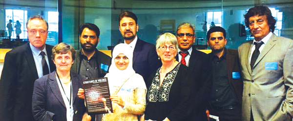 """Srinagar based HR group led by Khurram Parvez submitting """"Structure of Voilence"""" to EU Parliamentarians."""