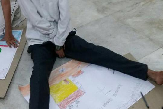 A specially abled student participating in the CRDP organized drawing competition.