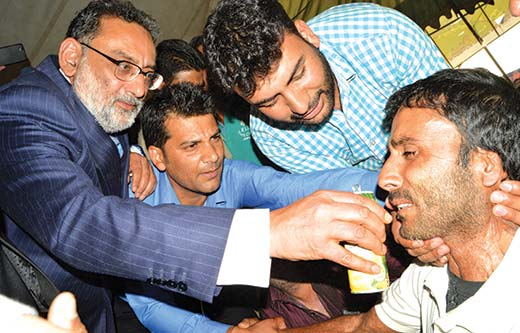 Dr-Haseeb-Drabu-with-PHE-daily-wagers
