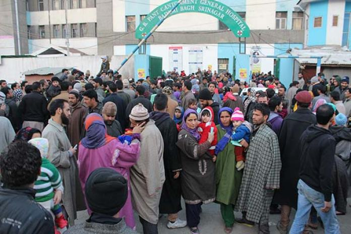 Anguished parents with their children outside GB Pant hospital on 17 January.