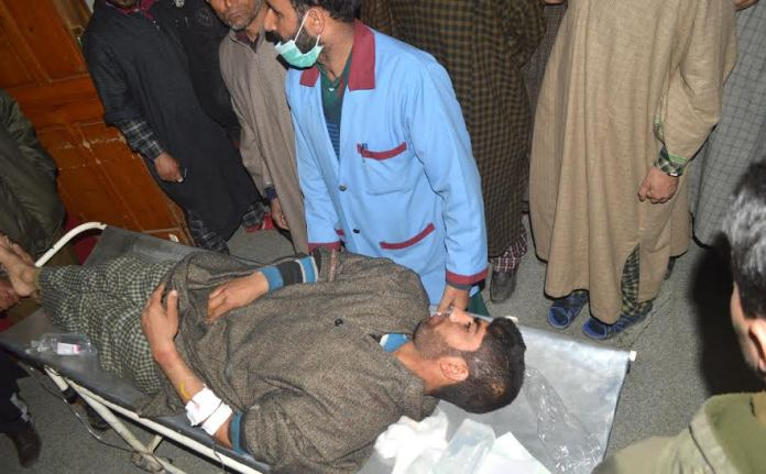 An injured civilian being shifted to hospital in Pulwama district.