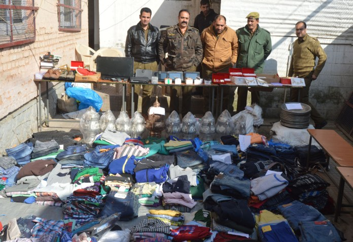 SHO Khanyar with colleagues displaying the seized stuff.