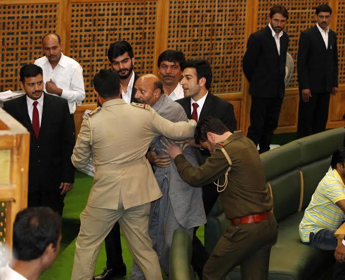MLA Langate Er Rasheed being marshalled out of the J&K Assembly on Monday during the budget presentation. (KL Image: Bilal Bahadur)