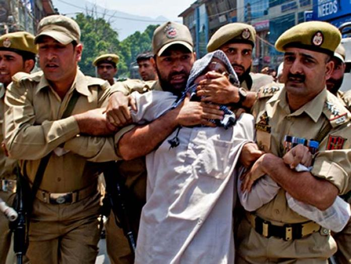 Mushtaq-ul-islam-being-detained-by-J&K-Police