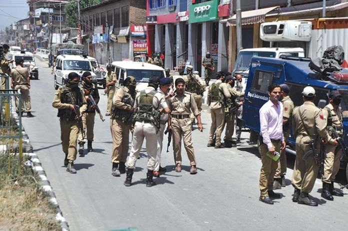Police near the spot where two cops were killed by militants in Islambad.