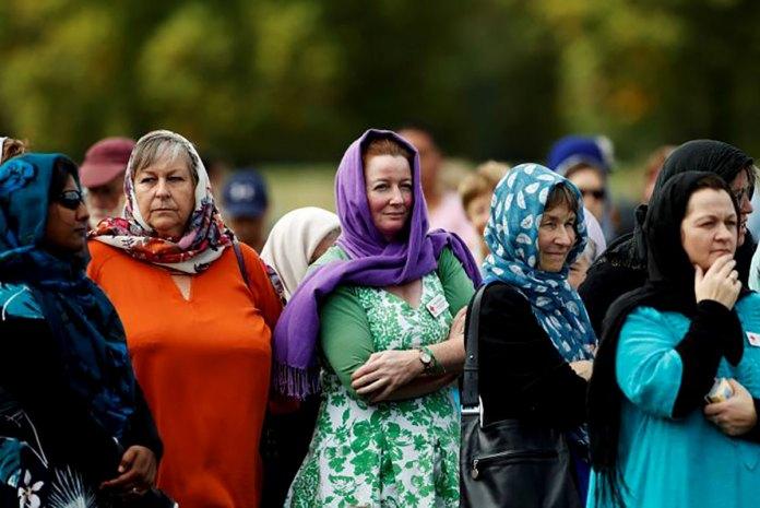 Women wearing head scarves in solidarity with NZ's Muslim community.