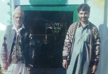 Bashir Ahmad with his father in this family photo.